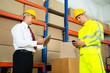 Постер, плакат: Warehouse Worker Checking The Inventory With Manager