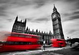 London, the UK. Red buses and Big Ben, the Palace of Westminster. Black and white
