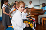 Fototapety Group Of Children Playing In School Orchestra Together