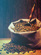 Coffee beans on burlap sack. Filtered image: warm cross processed vintage effect.