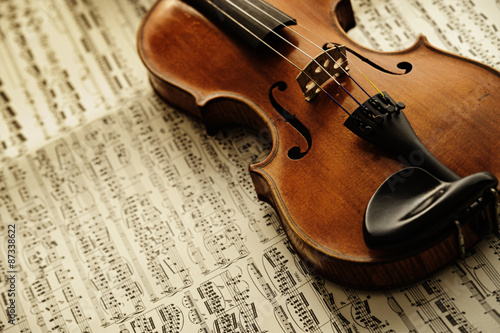 obraz lub plakat old and rare violin on a note sheet