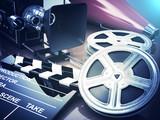 Fototapeta Video, movie, cinema vintage concept. Retro camera, reels and cl
