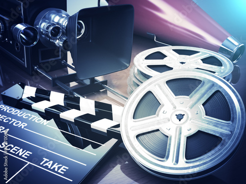 Video, movie, cinema vintage concept. Retro camera, reels and cl