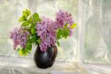 Naklejka bunch lilac in vase on the window sill