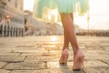 Fototapety Fashionable woman wearing high heel shoes