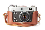 Fototapeta Vintage film camera with leather case
