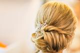 Fototapety Stylist makes wedding hairstyle