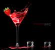 Obrazy na płótnie, fototapety, zdjęcia, fotoobrazy drukowane : Stylish Cocktail Glass with Strawberry Liquor Splashing. Party Concept
