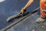 Worker using a special tool to spread mastic asphalt 3 poster