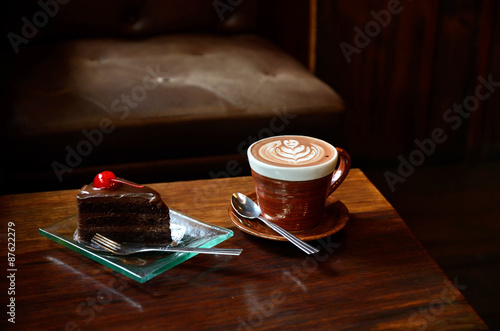 Fotobehang Thee Coffee and cake on wood table in coffee cafe