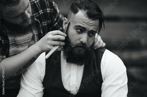 barber shaves a bearded man Poster