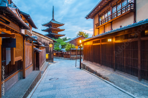 Japanese pagoda and old house in Kyoto at twilight Poster