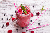 Fototapety Summer berries smoothie in a glass mug