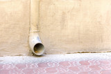 Dusty rainwater drain in a yellow wall poster
