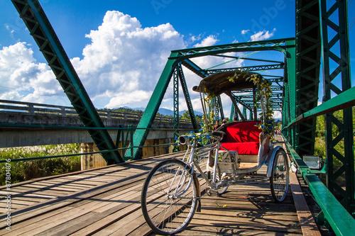 Foto op Plexiglas Indonesië tricycle on the bridge