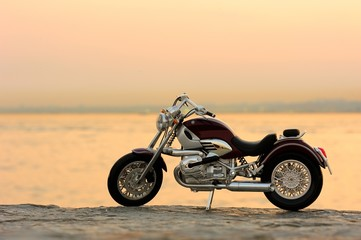 Motorcycle on the rocks in sunset and golden hours © FOTOALEM