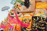 Fototapety Group of beautiful Balinese girls in bright traditional costumes - sarongs decorated by hindu Barong and Garuda masks. Arts and culture of Bali island and Indonesia people and asian travel backgrounds