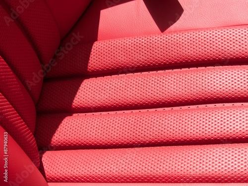 Plakat Edles rotes Leder des Fahrersitz eines Roadster Klassikers der Sechziger Jahre i