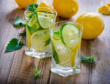 Lemon water with fresh lemons and mint.