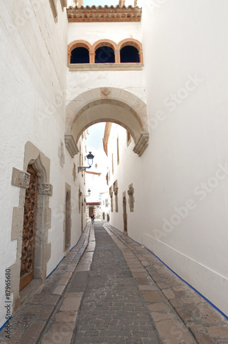 Obraz na Szkle Old street in Sitges ,Catalonia,Spain