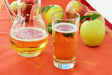Hard Apple Cider in glass and pitcher
