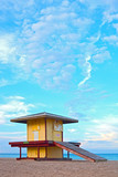 Hollywood Beach Florida, USA. Colorful lifeguard house at sunset with beautiful sumer sky and ocean in the background