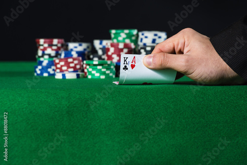 Plakat Closeup of poker player with two aces