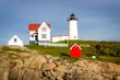 Maine Lighthouse under Dusky Blue Sky