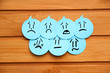 Постер, плакат: Sad emotions on blue stickers on wooden background Group of negative emotions