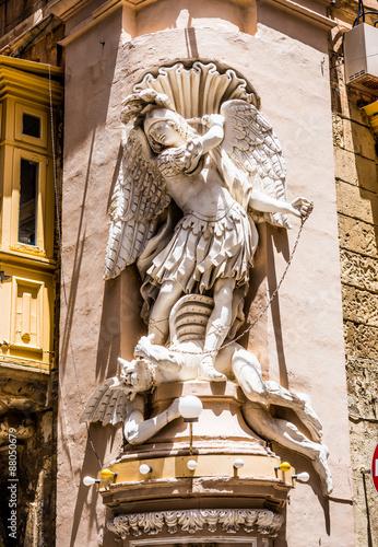 statue on a street of Valletta Poster