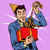Fototapety Male birthday unpacks the gift