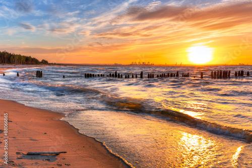 Zdjęcia na płótnie, fototapety na wymiar, obrazy na ścianę : Sunset on the beach at Baltic Sea in Poland