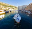 Yacht moored in city port in Dubrovnik. Croatia.