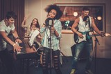 Fototapety Multiracial music band performing in a recording studio