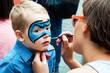 Obrazy na płótnie, fototapety, zdjęcia, fotoobrazy drukowane : Woman painting face of kid outdoors