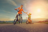 Fototapety Happiness Mother and son on the bicycles funning outdoor