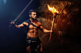 spartan on a dark background rocks, warrior, fighte holds a rais