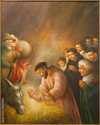 Fototapeta Cordoba - paint of st. Francis of Assisi in the scene of Nativity