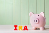 IRA theme with wood block letters and piggy bank poster