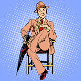 Fototapety Elegant man with an umbrella sitting on the stool