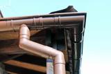Fototapety brown rain gutter on a home against blue sky