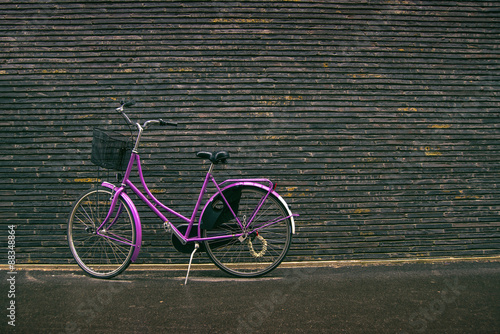 Classic Vintage Purple Hipster Bicycle on the Street