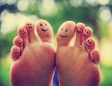 smiley faces on a pair of feet on all ten toes (VERY SHALLOW DOF