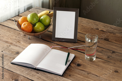 Poster Open blank notebook on a wooden table