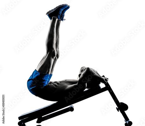 Fototapeta man exercising fitness crunches Bench Press exercises silhouette