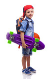 Fototapety Portrait of a school kid holding a skateboard and a basketball o