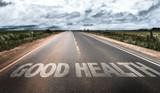 Fototapety Good Health written on rural road