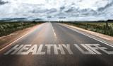 Fototapety Healthy Life written on rural road
