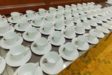Many white coffee cups are provided below.