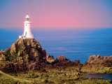 White lighthouse on Jersey Island. Image is toned